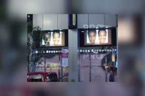 accent projection on glass store front side by side display